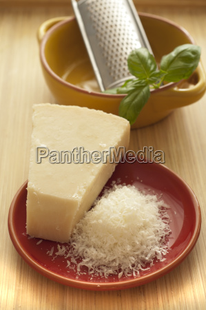 parmesan cheese with basil on wooden