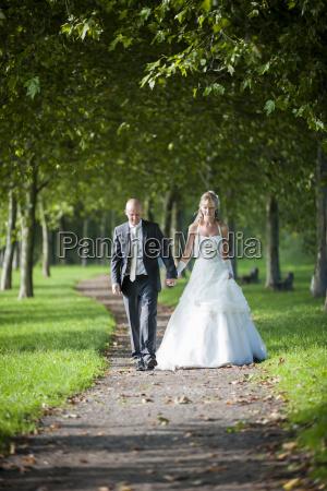 germany rhineland palatinate bridal couple walking