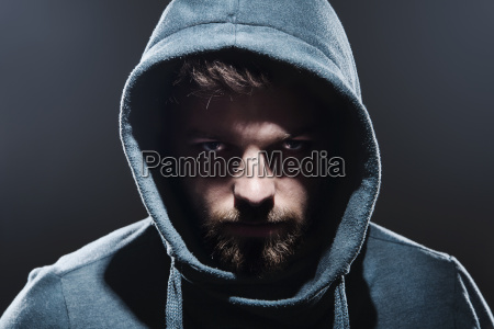 portrait of man with hooded jacket