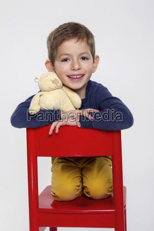 portrait of boy with cuddle toy