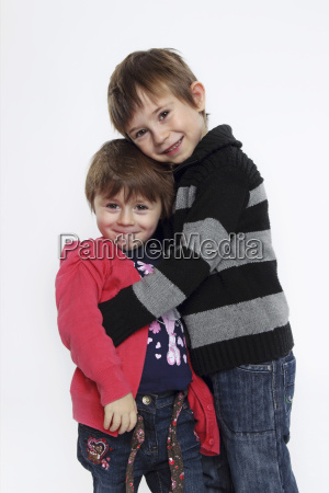 portrait of brother and sister embracing