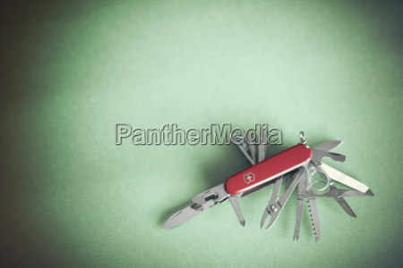 swiss army knife on green background