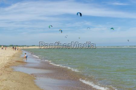 netherlands zeeland vrouwenpolder beach with kitesurfern
