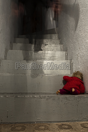 criminal walking upstairs with doll lying