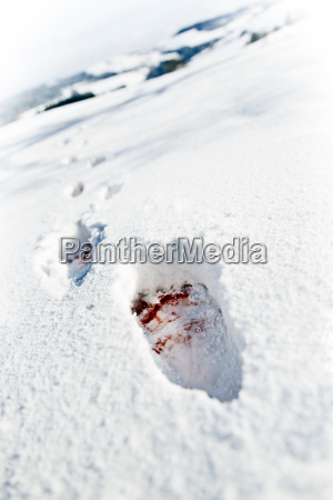 blood stained footprints in snow