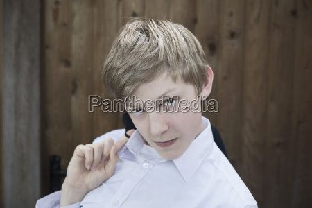 portrait of blond boy leaning with
