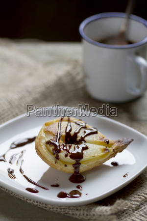 pear in puff pastry on plate