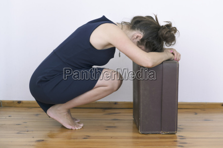 frustrated woman with suitcase