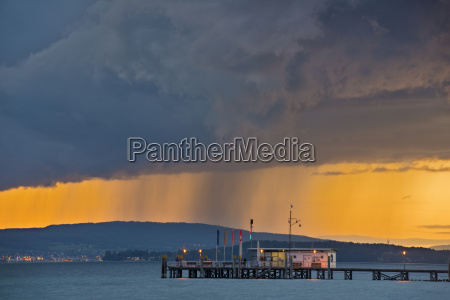 germany ferry jetty and rain clouds