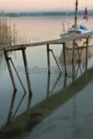 germany boat next to jetty reflecting