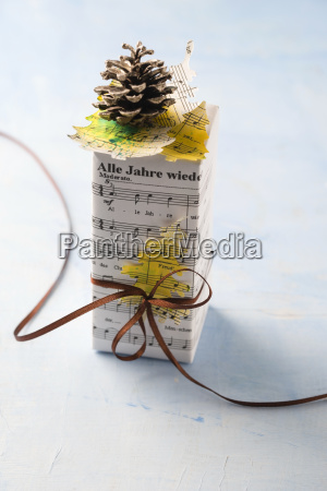 christmas present wrapped in music paper
