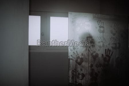 man in shower with hand prints