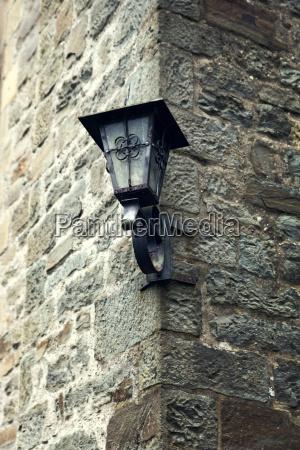 cast iron lamp at corner of