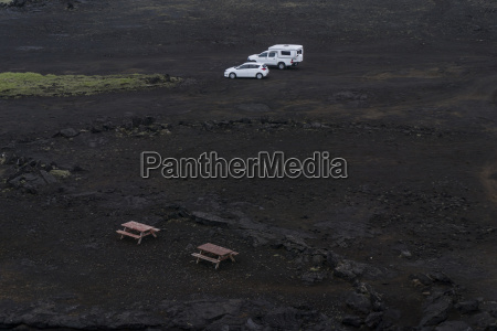 iceland parked cars in volcanic terrain