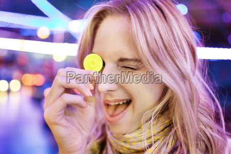young woman at fun fair covering