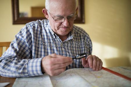 senior man looking at a road