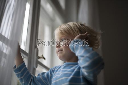 little boy looking out of window