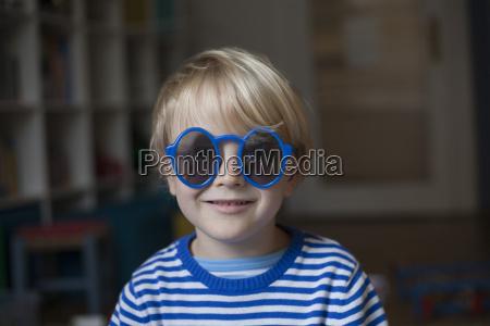 portrait of smiling little boy wearing