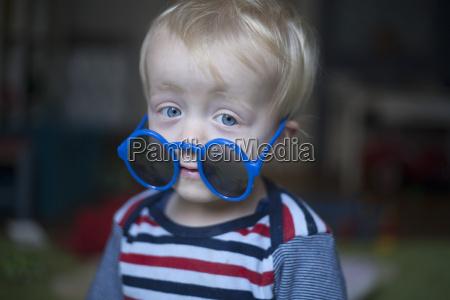 portrait of little boy with big