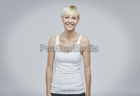 portrait of happy blond woman wearing