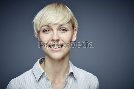 portrait, of, smiling, blond, woman, in - 21117667