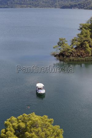 turkey province mugla boat and swimmers