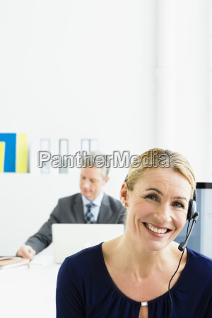 germany businesspeople working in office smiling