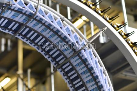 conveyor belt with brochures in a
