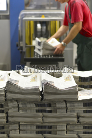 employee in a printing shop preparing