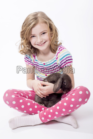 portrait of girl sitting with bunny