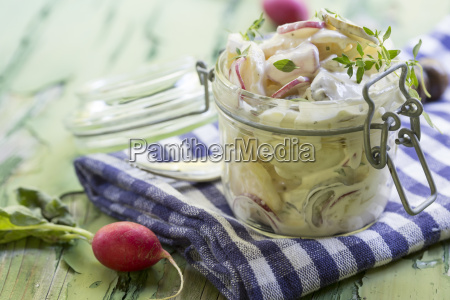 jar of potato salad with radish
