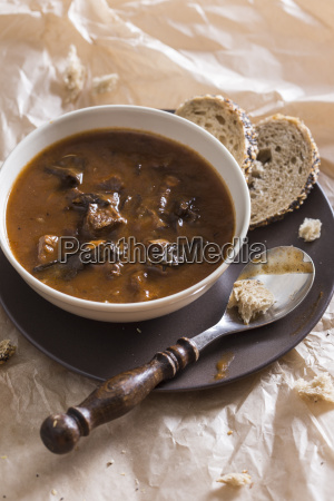 bowl of goulash soup with wild