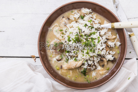 bowl of chicken fricassee with meatballs