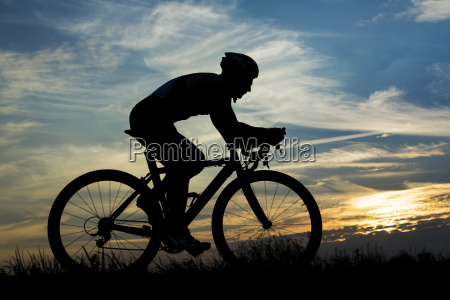 germany mature man riding bicycle in