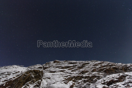 norway starry sky over mountain near