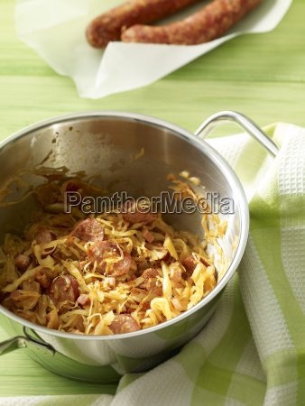 pot of sauerkraut with slices of