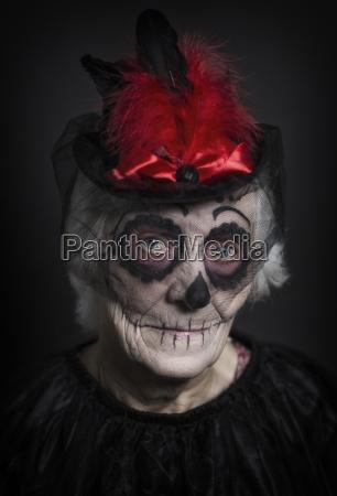 senior woman with sugar skull make