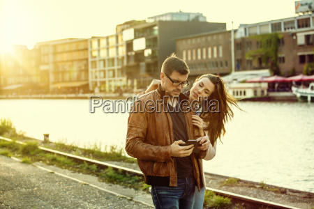 germany muenster couple looking at digital