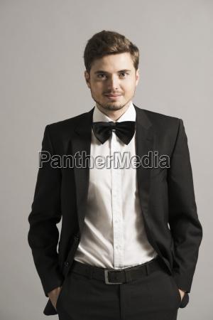 portrait of smiling man wearing tuxedo