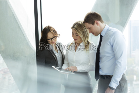 businesspeople in office with woman using