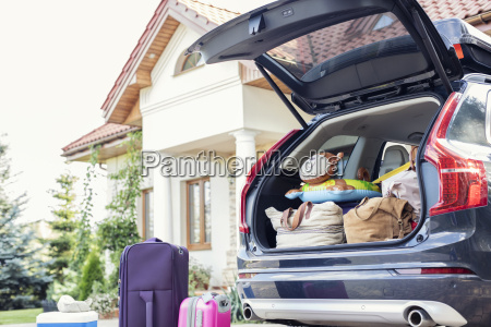 open car boot packed for family