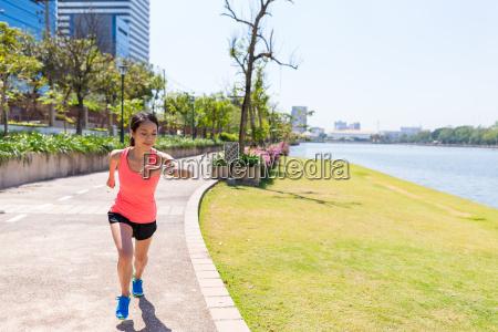 woman running in benjakitti park in
