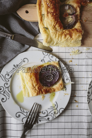 baked focaccia with red onions and