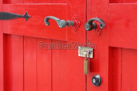 closeup of old wooden red door