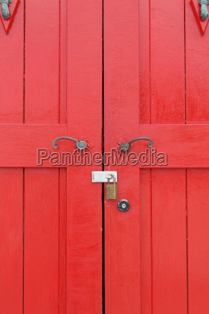 closed old wooden red door with