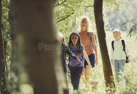 mother and daughters hiking in sunny
