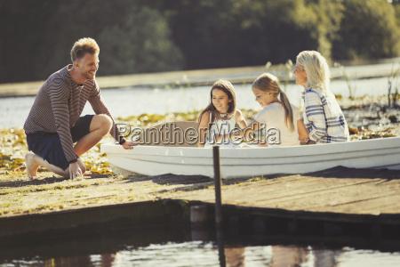 family in canoe at sunny lake