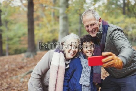 grandparents and grandson taking selfie in