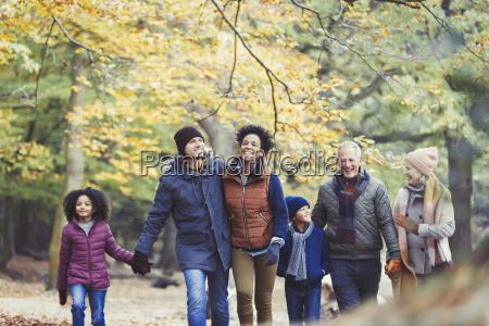 multi generation family walking in autumn