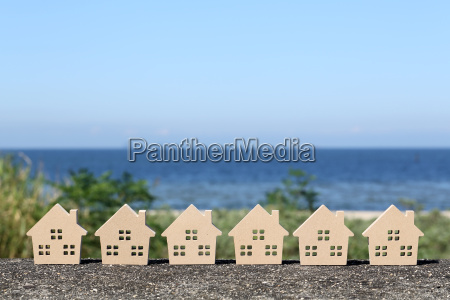 miniature model of house with blue